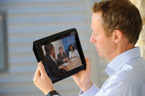 Man viewing video on tablet